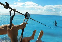 ziplining over the ocean