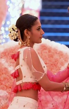 OH MY this blouse! I love the tassels and the split sleeve on this beautiful white lehenga saree blouse - such a clever design Blouse Back Neck Designs, Sari Blouse Designs, Fancy Blouse Designs, Blouse Patterns, Choli Designs, Sleeve Designs, Stylish Blouse Design, Lehenga Blouse, Lehenga Choli