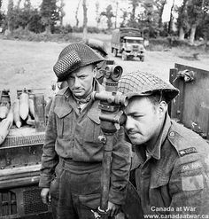 Sergeant D. Mills and Gunner H.W. Embree checking the gunsight of a Priest M-7 105mm. self-propelled gun of the 14th Field Regiment, Royal Canadian Artillery (R.C.A.), 20 june 1944.