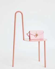 In stock: @jw_anderson logo purse in baby pink  Happy Valentine's Day! Don't forget we have an active promo code: LOVEKM20 14%OFF  today for everything  Pic by @theblueprint.ru  #km20 #km20online #jwanderson