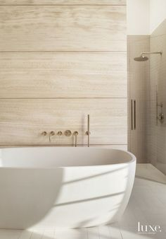 Modern Limestone Master Bath with Soaking Tub - Luxe Interiors + Design Modern Bathroom Design, Modern House Design, Bathroom Interior, Contemporary Design, Kitchen Design, Limestone Wall, Beautiful Bathrooms, Serene Bathroom, Natural Bathroom