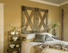 From a stash of two wood gates, these  once-horizontal boards now hang vertically above a bed as a headboard. By Shannon Quimby