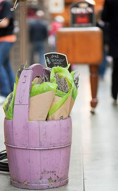 dried lavender--marketing genius...just look at that glorious lavender wooden bucket