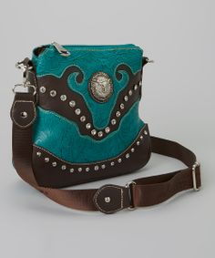 73a7ed3eb56 This Montana West Turquoise   Brown Rhinestone Steer Crossbody Bag by  Montana West is perfect!