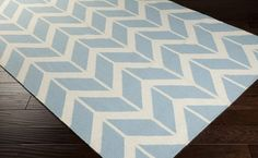 Surya Fallon FAL-1070 Area Rug From delicate lattice patterns to boldly colored chevron patterns the Fallon Collection makes a statement in flat weave; from creator Jill Rosenwald known for her beautifully colored, hand-made ceramics. The Fallon Collection's patterns and the hand woven flat weave construction beautifully combine to highlight its simplicity and sophistication. Fresh and fun patterned rugs with a strong designer color palettes.
