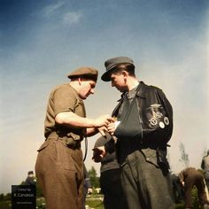 On May 10, 1945, in a field near the Dutch town of Soest, the remnants of the German 6. Fallschirmjäger Division, as well as ad hoc members of other units, including Cossacks, Waffen-SS and the 'Hermann Goering' Division, formally surrendered to the Allies, in this case to the 1st Battalion, Leicestershire Regiment. Among the men photographed that day was this Luftwaffe's veteran. His clothes and awards tell an interesting story: On his pilot's leather jacket, above the zipper, is pinned a K