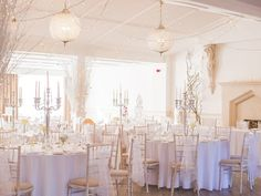 An all-white colour scheme works beautifully for a winter wedding. Image © Photography By Stefanie.