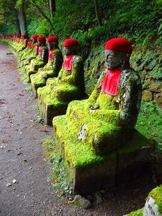 jizo statues alongside the Daiya River are considered the guardian deities of children and travelers - Japan