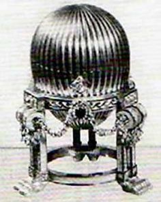 The Third Imperial Egg (The Gold Egg with Clock), three-tone gold, diamonds, sapphires, rose-cut diamonds, Vacheron clasp,1887. Presented by Alexander III to Tsarina Maria Fyodorovna. Lost.