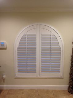 "60"" x 60"" Arch Window with 3.5"" Louver Plantation Shutters"
