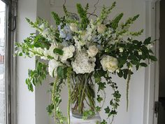 Unique design, white hydrangea, white snapdragons, white roses, white peonies, blue delphinium and lots of greenery