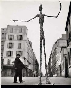 Skeletal Giacometti Sculpture on Parisian Street, by Gordon Parks - The brilliant Gordon Parks shot this image, in Paris, of an Alberto Giacometti sculpture just when that man was passing by in the background. Gordon Parks, Alberto Giacometti, Graffiti, Modern Art, Contemporary Art, Mary Cassatt, Land Art, Pablo Picasso, Art Plastique