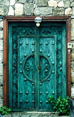 Teal door on Cyprus Island in Europe.
