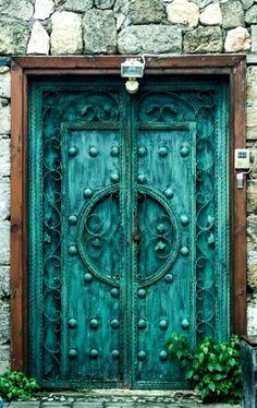 Teal door on Cyprus Island in Europe.