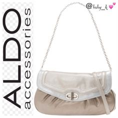 Aldo Henault Clutch-Cross-Body or Shoulder Bag Versatile handbag made of synthetic leather. ; Holds your wallet, keys, personal technology and a few small cosmetics. ; Bold detailed hardware. ; Contrast trim adds an edgy flair. ; Twist-lock flap closure. ; Interior lining with a back wall zip pocket, cell phone and PDA pockets. ; Bottom Width: 12 in ;Depth: 1 1 2 in ; Height: 7 1 4 in ; Strap Length 10 3 4 in ; Acc. Strap Length (long): 23 3 4 in There is a small slit at the back but hardly…