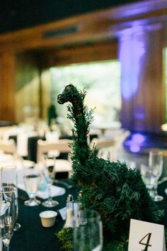 Dinosaur topiaries and punk rock shoes at this museum wedding on @offbeatbride