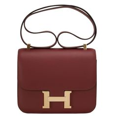 Hermes Rouge H Veau Sombrero Constance 24cm Gold Hardware. Red  LeatherLeather PursesLeather ... fb31e743a0f8b