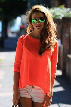 Love the look. Ray bans, shorts and bright and sweater.
