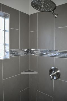 Master walk in shower with glass block window and beautiful tile detail