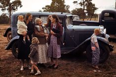 A family and their car, Pie Town, New Mexico, 1940, photographed by Russell Lee.