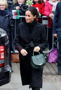 The former Suits star, 36, carried a bag from DeMellier London who fund life-saving vaccines for children for every bag sold