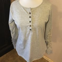Gray Lace sleeve top size small Gray Lace sleeve top. Tag reads size large but it fits like s small. Soft fabric. Never worn just use as display in store. Buttons at the top Tops Tees - Long Sleeve