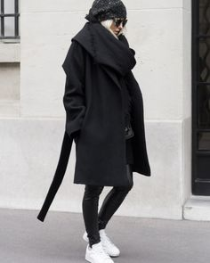 """fashion-clue: """" justthedesign: """" Figtny shows us how to wear all black in this gorgeous wool wrap coat and edgy leather leggings. Coat/Leggings: Net A Porter, Sneakers: Mango. """" www.fashionclue.net