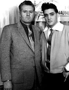 Elvis and his daddy Vernon. Getting a photo taken whilst Elvis is preparing for an appearance. This got me thinking, I can't remember seeing any singer/actor of the 50's and beyond that had their parents so front and centre of their career.