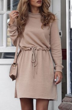 Sleek yet comfy, features with waist drawstring and long sleeve, this khaki mini dress is the perfect addition to your wardrobe. Get it only here!