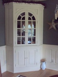 corner china cabinet built-in. simple with beautiful molding