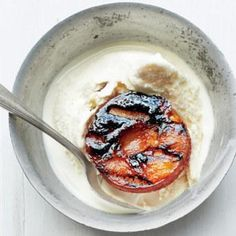 Grilled Plums With Vanilla Ice Cream recipe Lightly charred brown sugar gives in-season stone fruit an extra edge.           8 ITEMS OR LESS, BROWN SUGAR, BUTTER, GLUTEN-FREE, PLUMS, QUICK/SPEEDY, VANILLA ICE CREAM