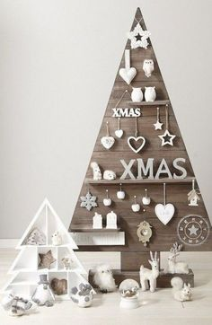 a plywood Christmas tree with shelves with figurines and ornaments