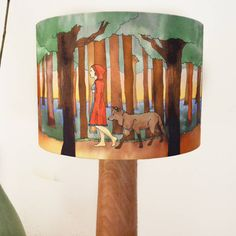 Red Riding Hood Lampshade by Ceridwen Hazelchild Design, the perfect gift for Explore more unique gifts in our curated marketplace. Ceiling Shades, Standard Lamps, Bedside Lamp, Ceiling Pendant, Red Riding Hood, Beautiful Lights, Lamp Bases, Printed Cotton, Wolf Walking