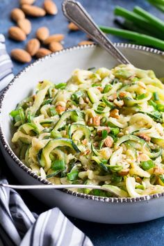 These almond butter sesame zucchini noodles are a delicious healthy makeover of classic sesame peanut noodles! The creamy almond butter sauce is sweetened just the right amount with dates and loaded with chopped almonds and scallions. Paleo an Real Food Recipes, Vegetarian Recipes, Cooking Recipes, Healthy Recipes, Scd Recipes, Zoodle Recipes, Paleo Whole 30, Whole 30 Recipes, Sin Gluten