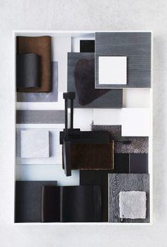 Lyst interiør med brytning av blå/grå og svart. Det brune gjør at fargevalget ikke blir så monotont.