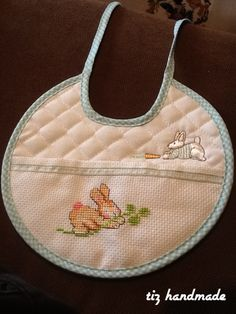 Cross stitched bib with rabbit Bib Pattern, Cross Stitch Baby, Welcome Baby, Kids And Parenting, Hand Embroidery, Sewing, Knitting, Rabbit, Creative Crafts