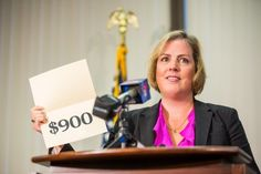 Acting Alaska Revenue Commissioner Angela Rodell announces the 2013 Permanent Fund Dividend. Sept. 18, 2013 -Loren Holmes photo from the Al...
