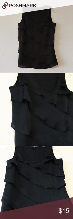 NWOT Tommy Hilfiger Black Tank Never worn! Brand new. NWOT Black Tommy Hilfiger tank with ruffles  Sheer, smooth, silky material- 100% Polyester Size S Smoke-Free and Pet-Free Home! Tommy Hilfiger Tops Tank Tops