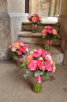 bride and bridesmaids bouquets, hot pink and peach spring flowers from www.bettierose.co.uk