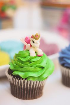 Cupcakes at a Rainbow Themed My Little Pony Party with Such Cute Ideas via Kara's Party Ideas | KarasPartyIdeas.com #RainbowParty #MyLittlePonyParty #mylittleponycupcakes