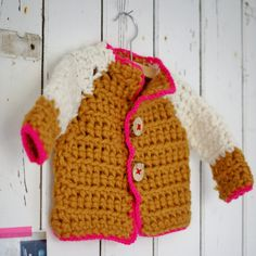 Crocheted cardigan with neon pink star on the back