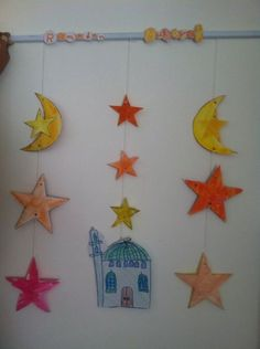 We'll make a wall hanging similar to this, with stars, moons, and a mosque. Kids can cut and colour, my oldest might also draw some of the shapes, insha'allah!