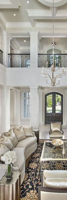 A STUNNING LIVING ROOM AND FOYER.NOTICE THE ARCHITECTURAL FEATURES,CEILING,FRONT DOOR AND BALCONY.CHERIE