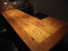 This is a custom wine bar with a tabletop crafted with wooden wine crate panels