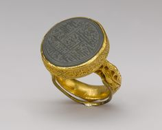 Seal ring with inscription, Timurid period (1370–1507), late 15th–early 16th century. Iran or Central Asia. Gold, cast and chased; nephrite, carved.