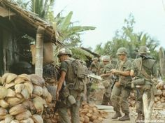 Members of the 47th Infantry, 2d Brigade, 9th Infantry Division search a village near Ben Tre...