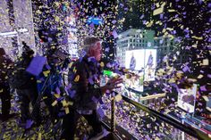 Confetti engineer Norm Larsen tosses confetti onto revellers from the roof of the Marriott Marquis hotel during New Year's Eve celebrations in Times Square in New York December 31, 2014. REUTERS/Keith Bedford
