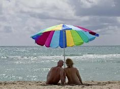 """It seems fitting that the Sunshine State would be a magnet for sun worshipers from around the world. But it's more than just a place for naturists to gather, says Ralph Collinson, president of the American Association for Nude Recreation, Florida Region. It's the place.  A New Jersey couple relaxes on this clothing-optional portion of Haulover Beach. - Patrick Farrell for VISIT FLORIDA """"Pasco County is actually known as the nudist capital of the world,"""" he says. Pasco, the semi-rura..."""