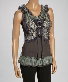 With an embellished bustline, ruffled straps and silk-blend softness, this tunic is pretty much perfect. Its fitted top and couture-kissed accents create effortless elegance that works for both luncheons and dinner parties.