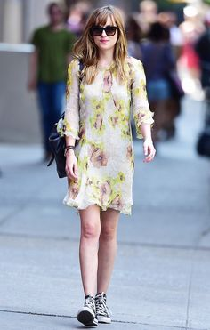 Dakota Johnson in a cool '90s-inspired floral dress with Converse
